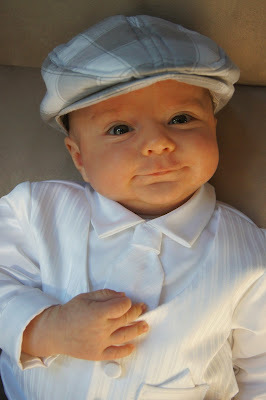 baby in baptism suit