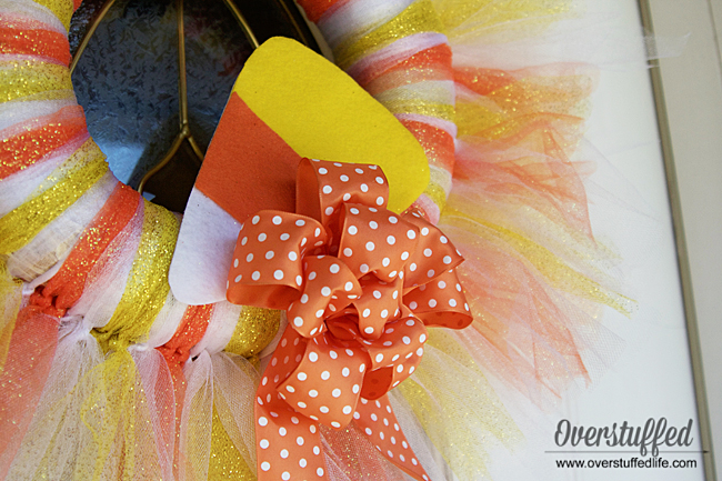 Finish off your Halloween tulle wreath with a felt candy corn decoration and an orange polka dotted bow