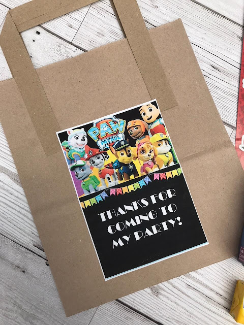 Brown paper party bag with a Paw Patrol sticker