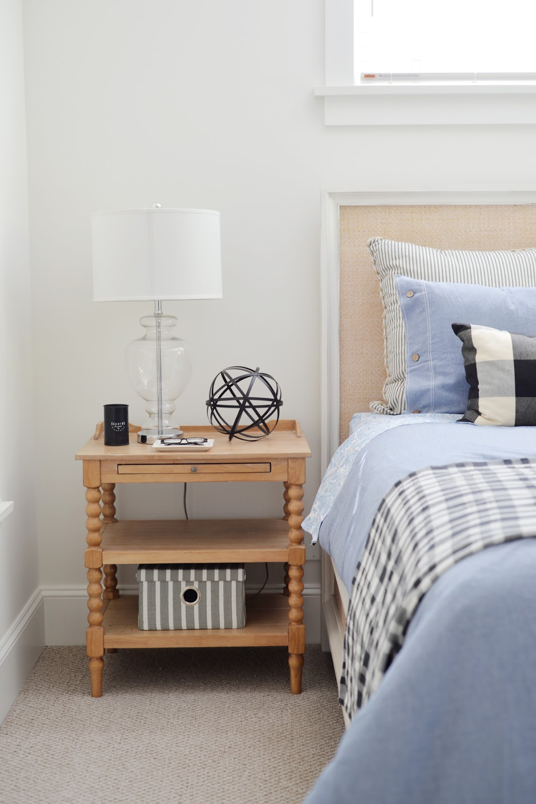 Ramblingrenovators.ca | Buffalo plaid pillow, spool side table, rattan headboard, modern country style cottage