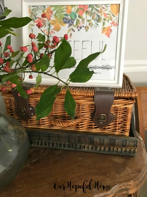 vintage thrifted wicker suitcase picnic basket leather strap brass closure
