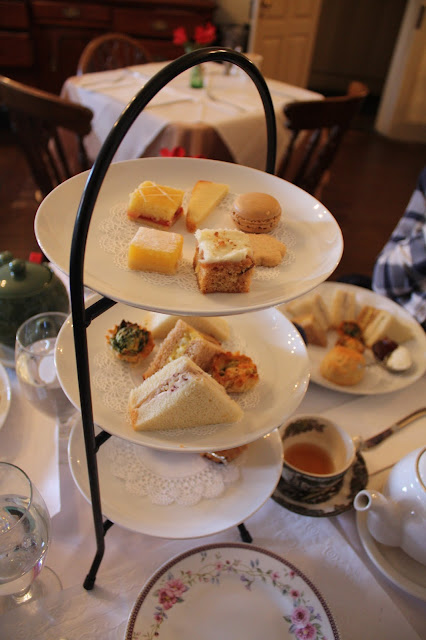 Variety of tea sandwiches, sweets, scone and preserves during tea service at Reynold's Tavern