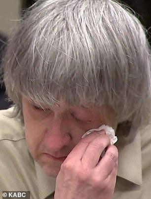 Couple weep as they are sentenced to life for torturing their 13 kids