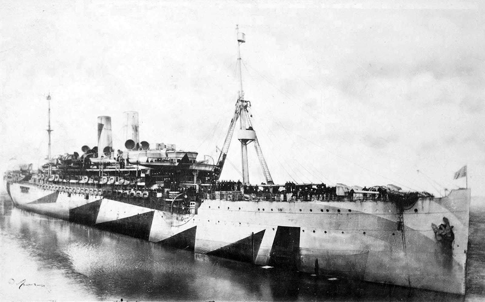 The USS Pocahontas, a U.S. Navy transport ship, photographed in Dazzle camouflage, in 1918. The ship was originally a German passenger liner named the Prinzess Irene. She was docked in New York at the start of the war, and seized by the U.S. when it entered the conflict in April 1917, and re-christened Pocahontas.
