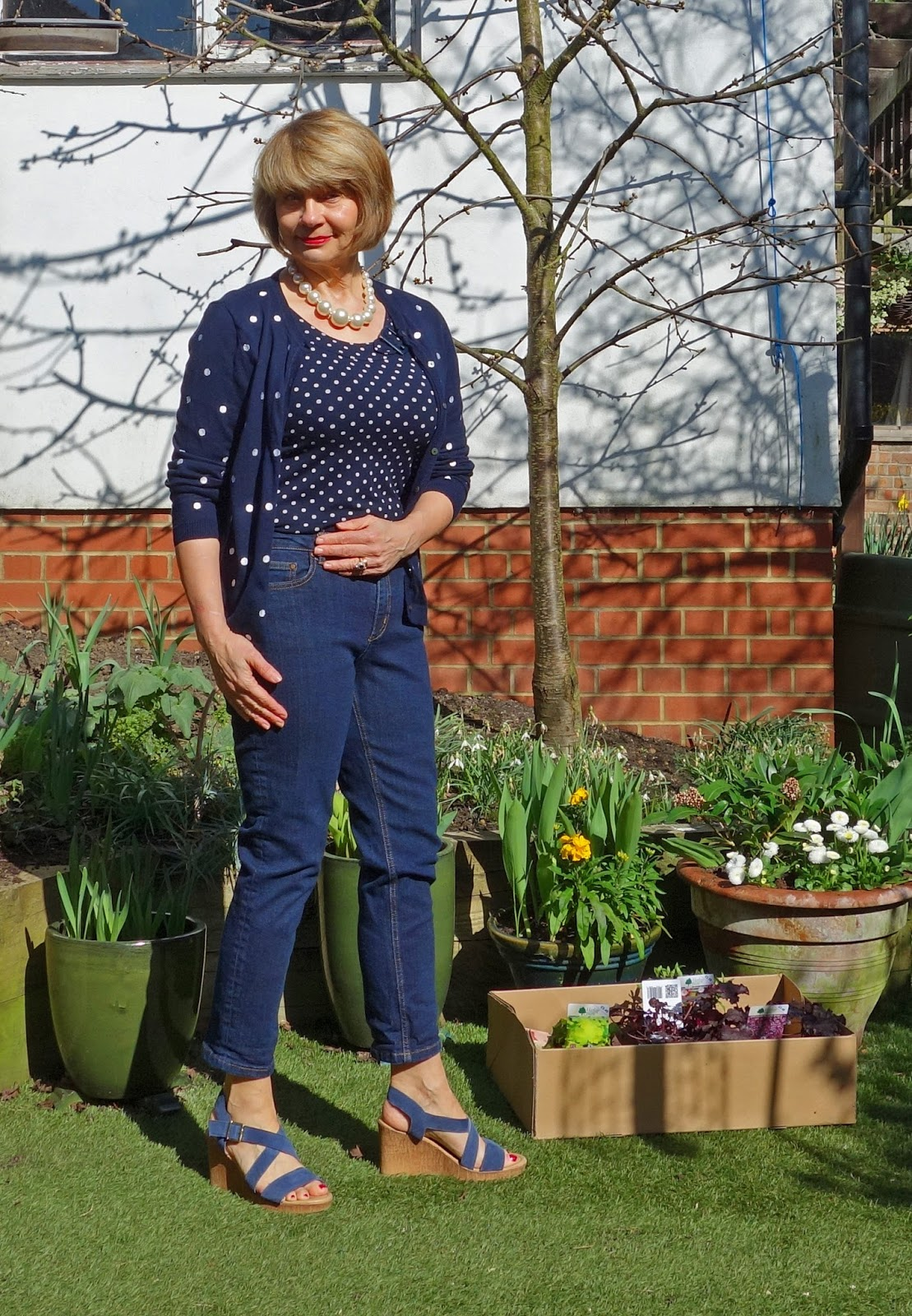Image showing polka dots in a navy outfit with jeans and pearls