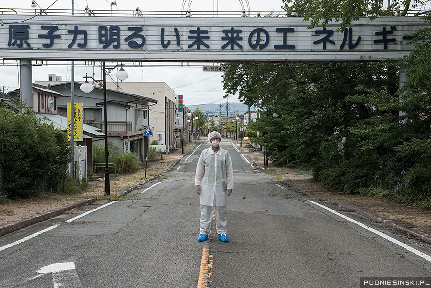 """Nuclear energy is the energy of a bright future"" reads the sign - Never-Before-Seen Images Reveal How The Fukushima Exclusion Zone Was Swallowed By Nature"