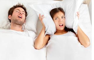 sleeping couple snoring
