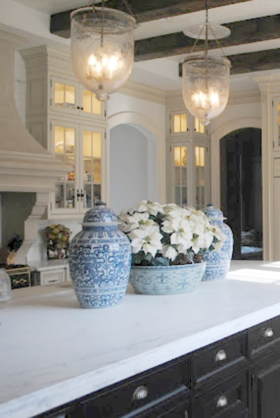 Orchids on island in blue and white French inspired Enchanted Home kitchen