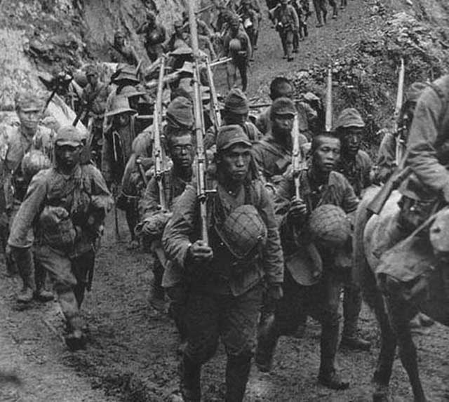 Japanese troops marching to Bataan, January 1942 worldwartwo.filminspector.com