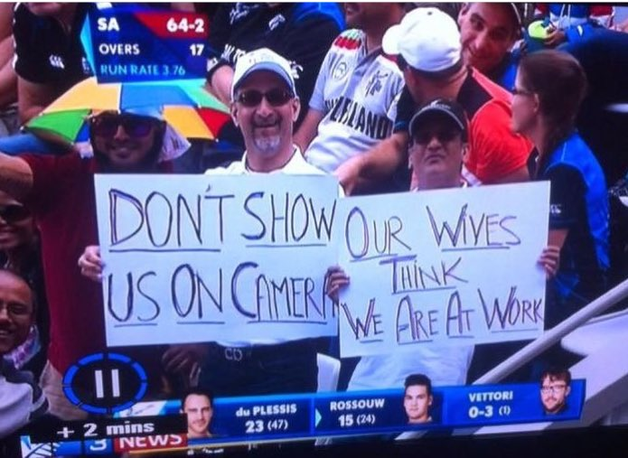 funny sign by boys in cricket game