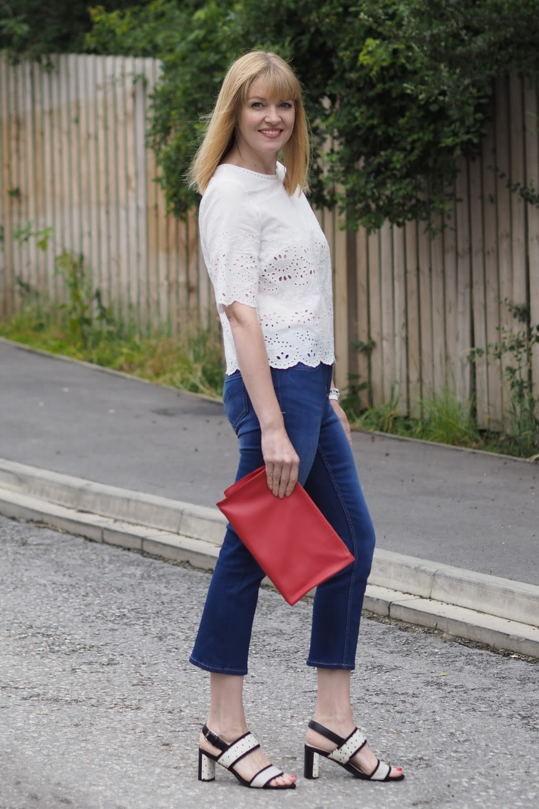 White Marksand Spencer broderie top, cropped flared jeans, back and white spotted sandals
