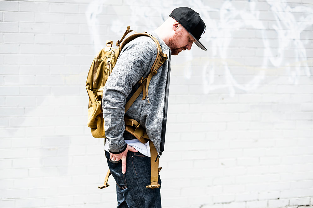 Nike Sportswear Heather Grey Tech Knit 2.0 / Visvim Ballistic 20L 'Mustard' Backpack / Denham The Jeanmaker Razor VIS Raw Selvedge Jeans by Tom Cunningham