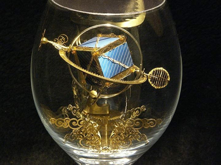 11-Solar-Kinetic-Miniature-Sculptures-in-a-Glass-Goblet-www-designstack-co