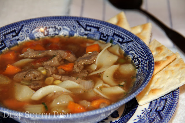 Good old fashioned vegetable beef soup, shortcut with lean sirloin in a beef and tomato base, with onion, celery, carrots, potatoes, corn and whatever leftover or frozen veggies you have on hand.