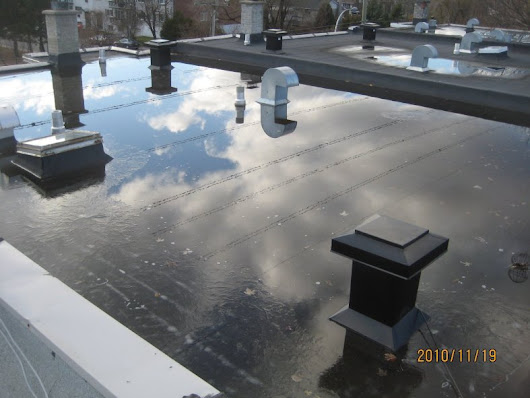 The 4 Most Common Causes of Commercial Flat Roof Leaks