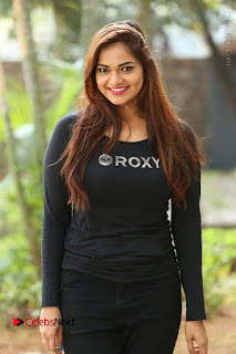 Actress Aswini Latest Stills in Black Denim Jeans  0100.JPG