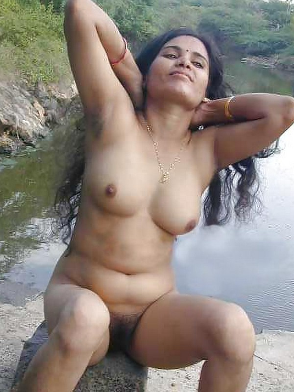 Nudist holding it