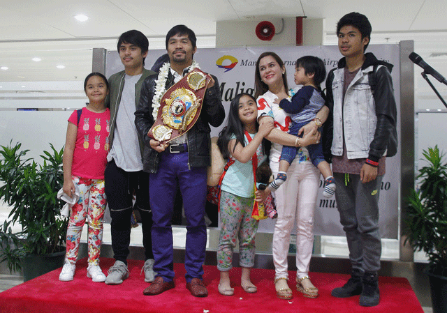 Pacquiao returns to Manila after win over Bradley