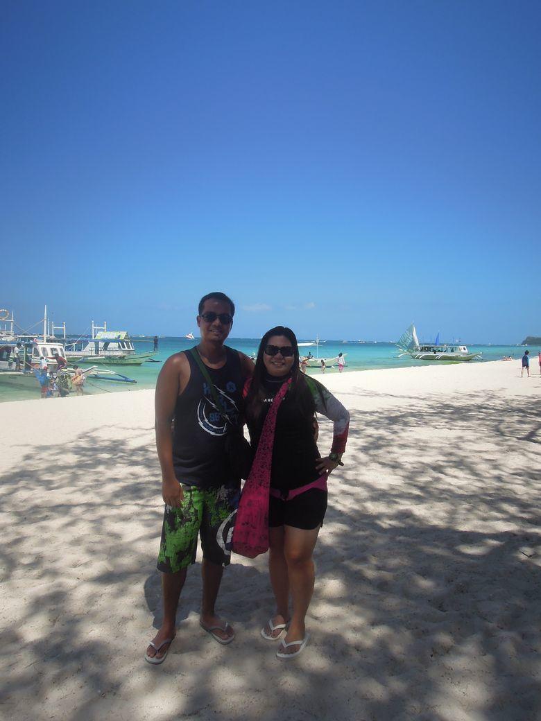 Couple travel bloggers enjoying the beach in Boracay