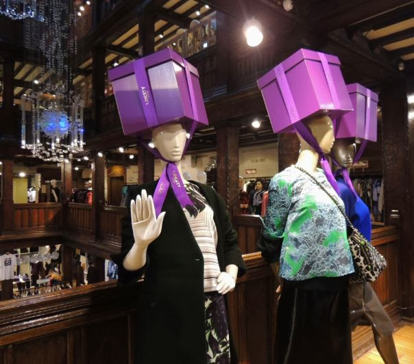 Purple Liberty boxes on mannequins as hats