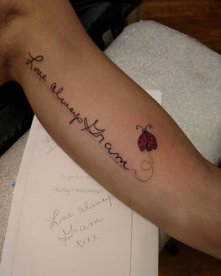 small lady bug tattoo