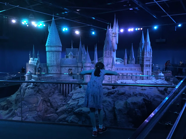 sasha overlooking giant hogwarts model