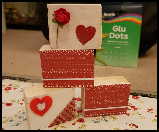 Using Valentine papers and accessories to glue on to wooden blocks