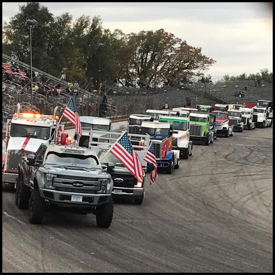 Indomitus - the Minnesota Soybean BioDiesel truck - leads the Bandits around Elko Speedway prior to the start of the a-main feature.