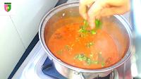 image of adding chopped coriander in rajma