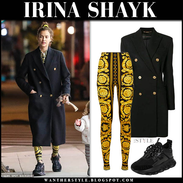 Irina Shayk in black oversized versace coat, yellow leggings and black sneakers model street style january 4