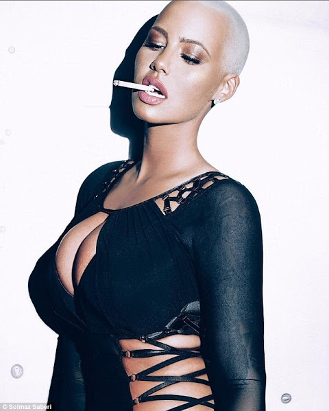 Amber Rose puts on a busty display as she flaunts her wicked curves in sexy shoot.