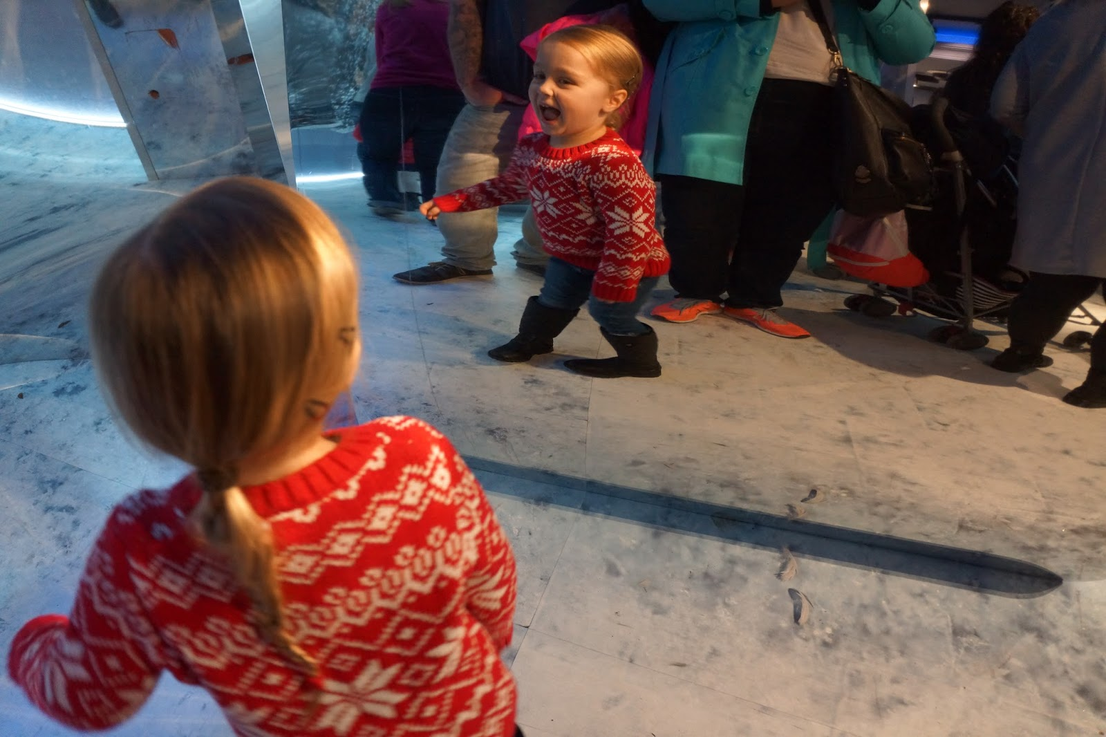 girl playing in front of distorting mirrors at harrods christmas grotto 2016