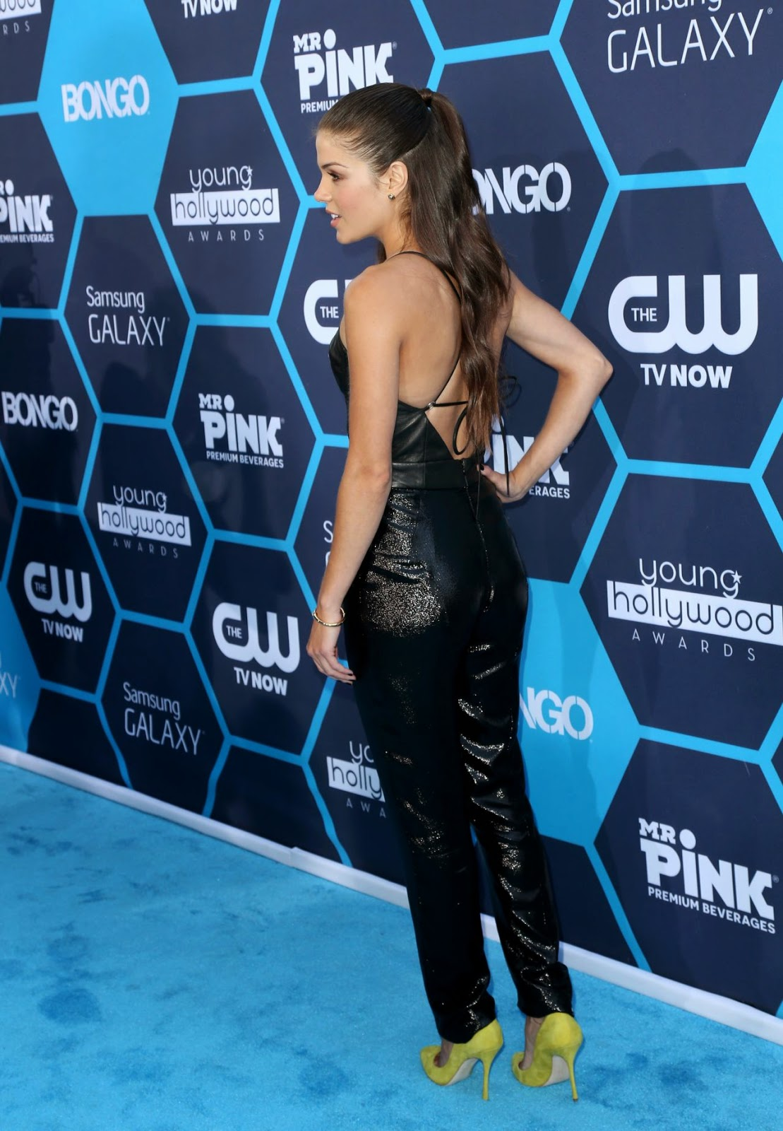 Marie Avgeropoulos in an Olcay Gulsen jumpsuit at the 2014 Young Hollywood Awards