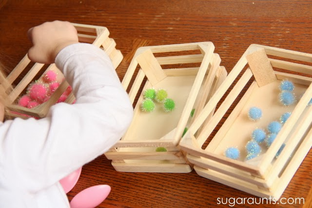 Kids can sort pom poms using tongs for fine motor play