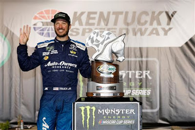 Martin Truex Jr., driver of the #78 Auto-Owners Insurance Toyota, poses in Victory Lane after winning the Monster Energy NASCAR Cup Series Quaker State 400 presented by Walmart at Kentucky Speedway on July 14, 2018 in Sparta, Kentucky.