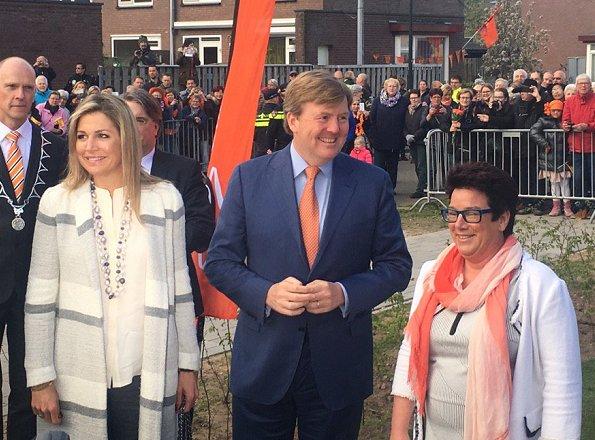 Queen Maxima wore Zara Stripe Duster Long Coat, Gianvito Rossi Pumps and carried Salvatore Ferragamo handbag,