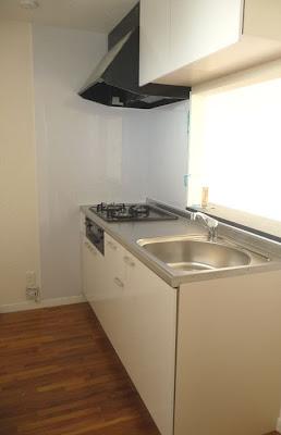 集合住宅の床に使用したチーク無垢フローリング・キッチン