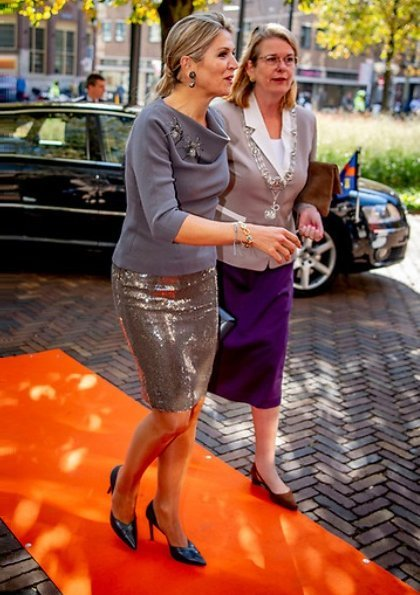 Queen Maxima gave an opening speech at the MKB Nederland congress in The Hague. Queen Maxima wore Sequin midi skirt and grey wool top