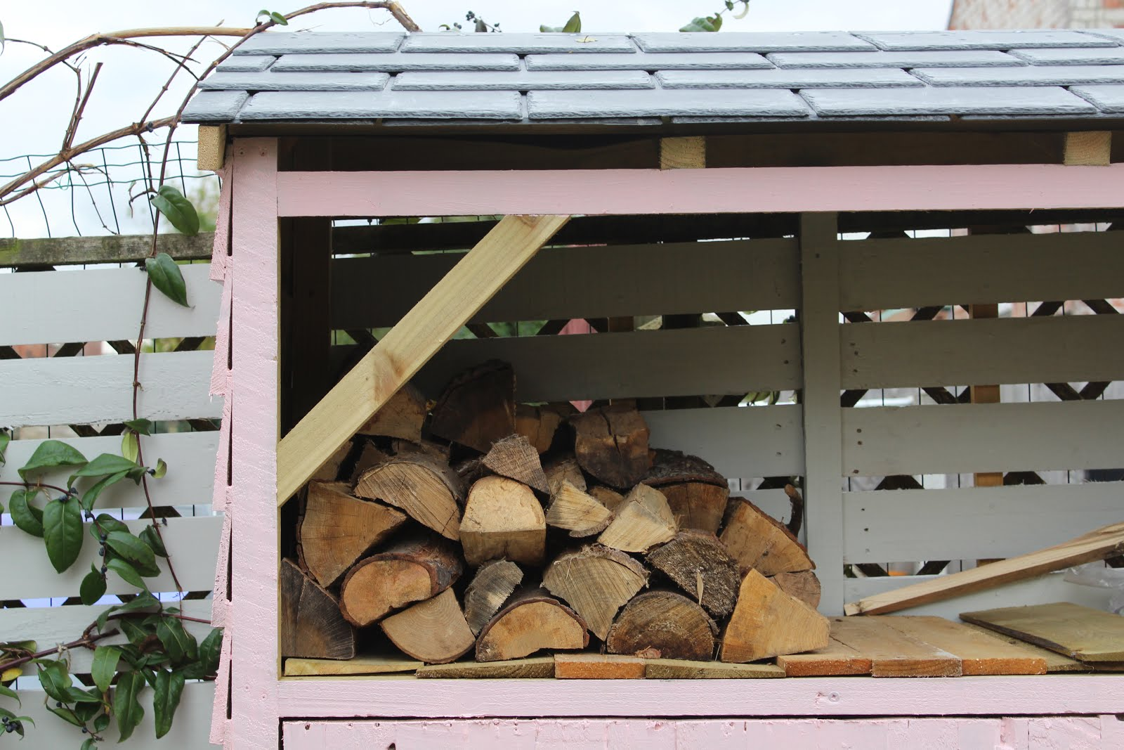 DIY log store painted pink