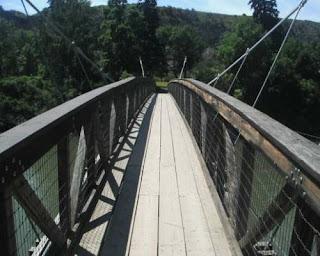 View of bridge over Missouri River going to Ryan Island park Montana