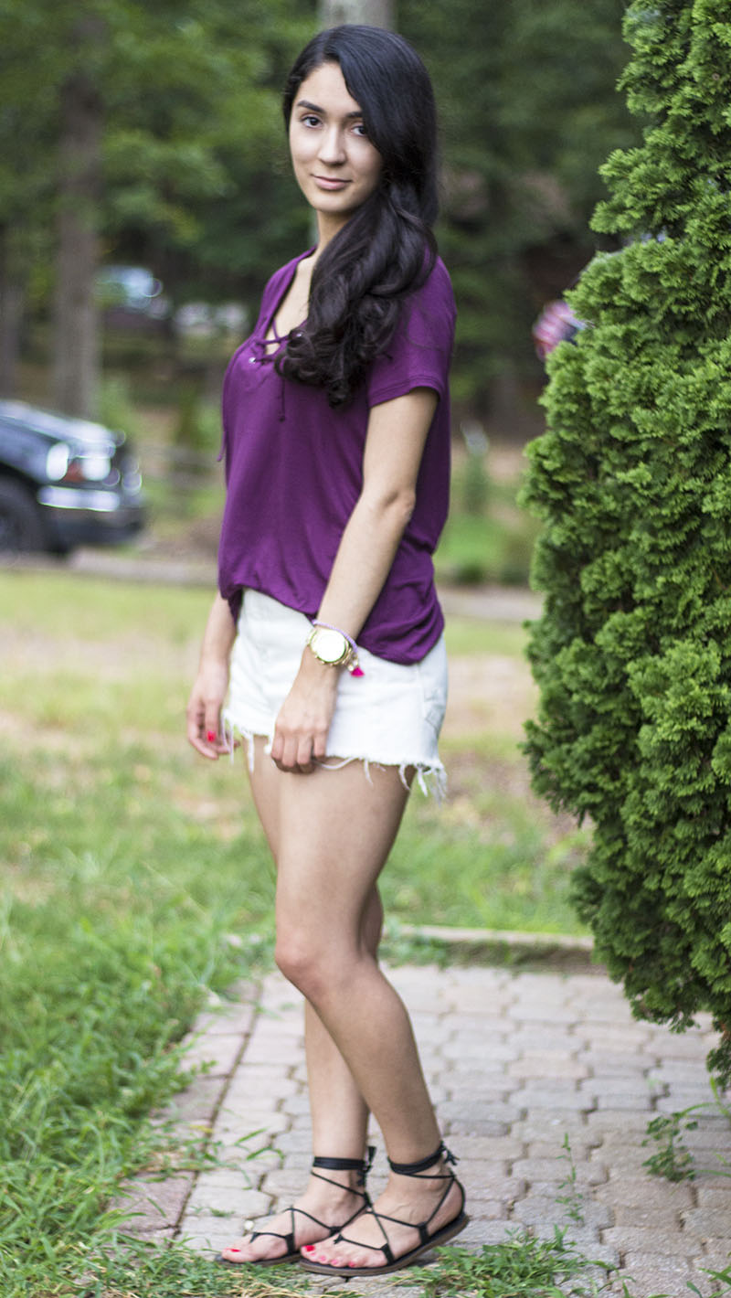 purple lace up top and white denim shorts outfit