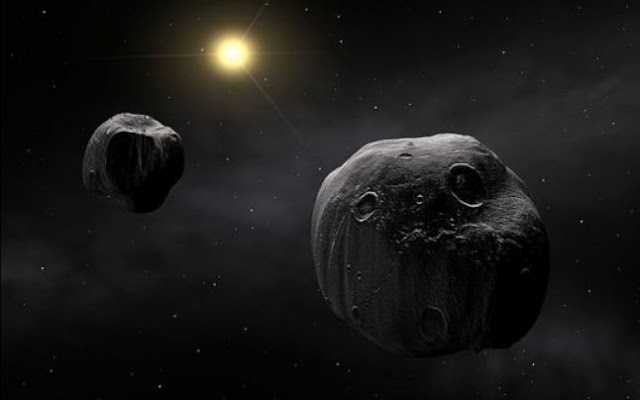 dois asteroides orbitando o Sol