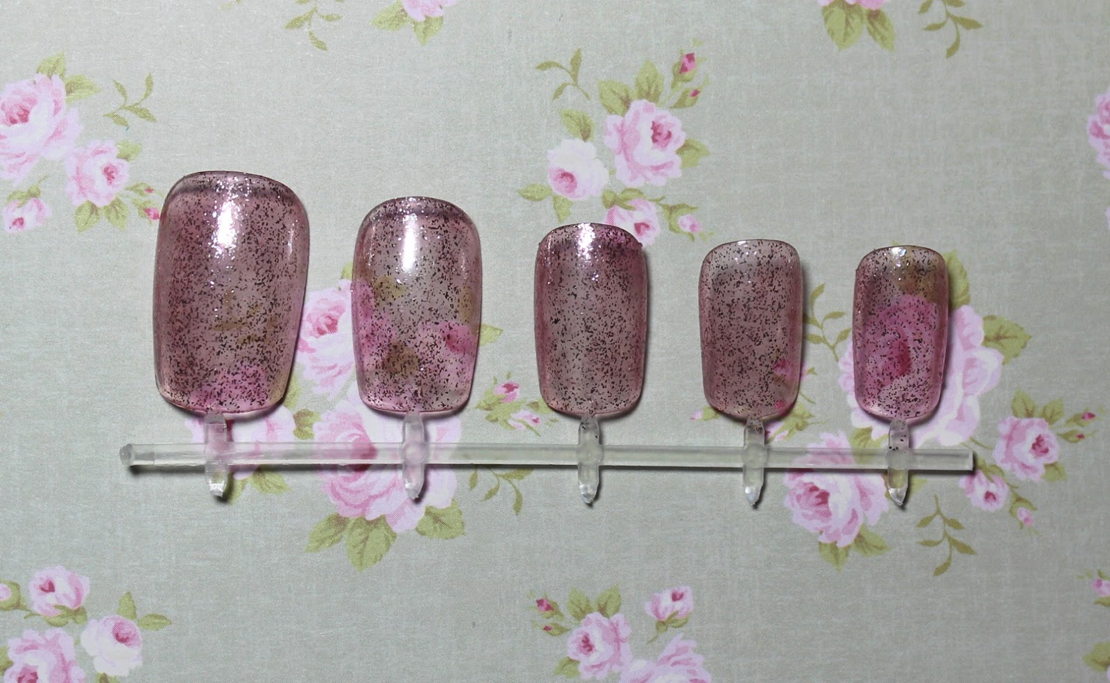models own glittergel crystal pink swatch