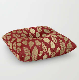 Red and gold leaf pattern floor pillow