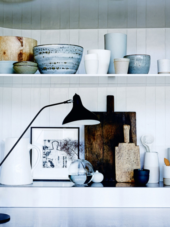 Eclectic beach home in Sydney. Open kitchen shelves. Photo by Anson Smart via Vogue Living