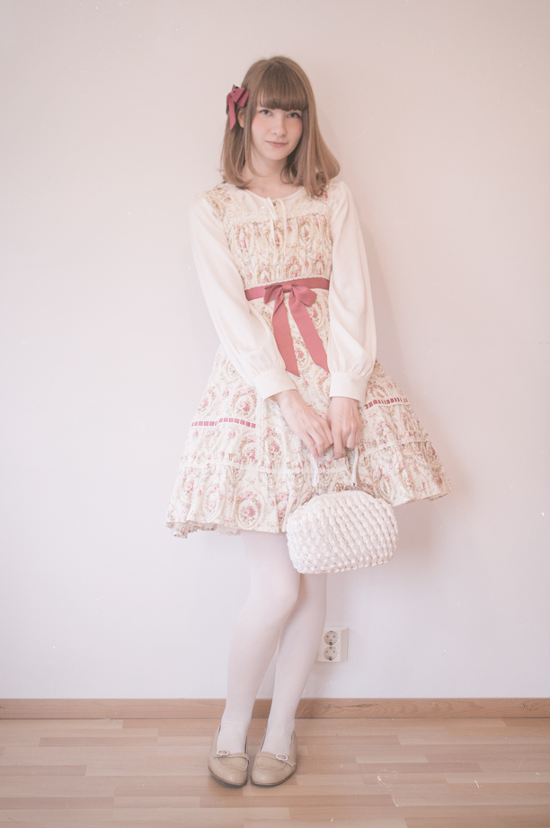 classic sweet finnish lolita posing and holding a vintage bag