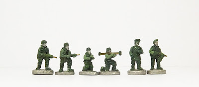 Advancing with sten / firing Bren MG / M20 Bazooka with loader / Officers x 2: