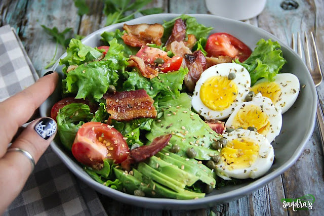 BLT - Bacon, Lettuce, and Tomatoes with boiled eggs, avocado and delicious homemade vinaigrette.