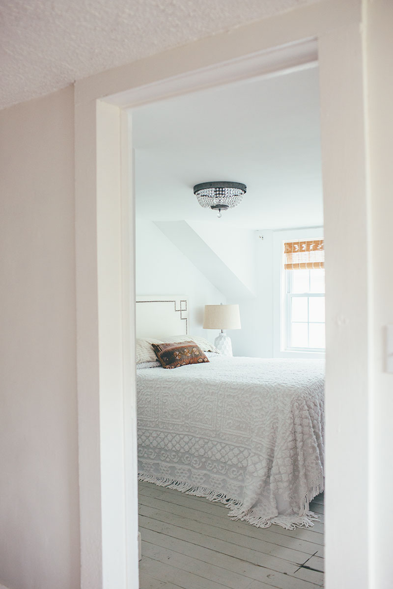 Entrance to white minimalist boho master bedroom