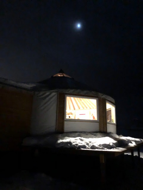 Outside our observing yurt with cloud view of moon in Iphone image (Source: Palmia Observatory)